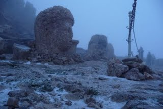 mysterious stone heads in the mist